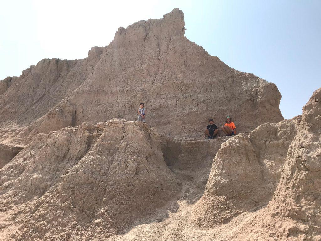Kids climbing at the Badlands
