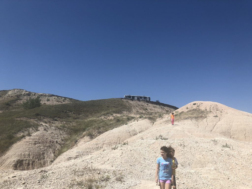 Kids hiking at Badlands campsite