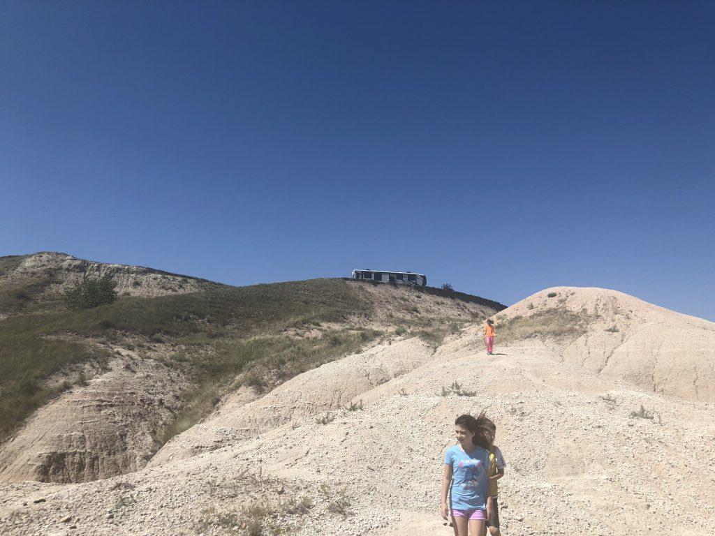 Kids hiking at Badlands campsite