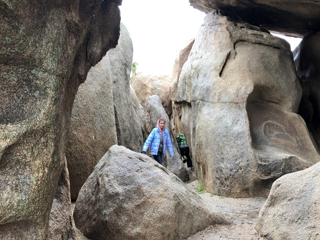 Joshua Tree National Park with the Kids at Hidden Valley picnic area playing on the boulders