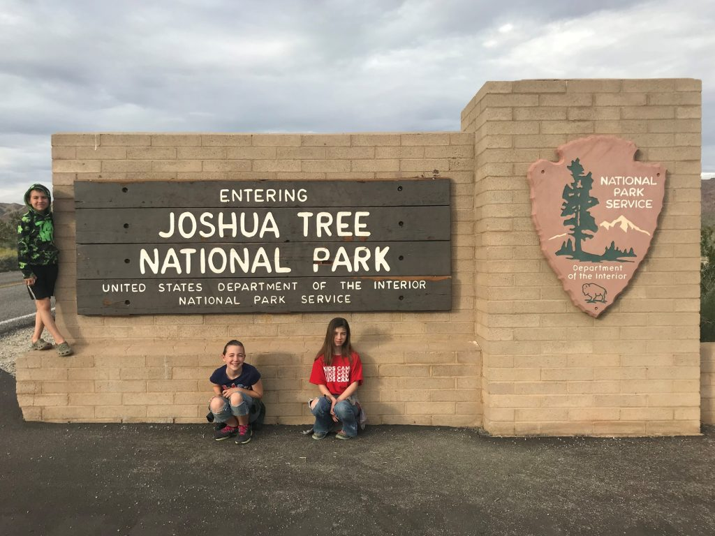 Joshua Tree National Park with the kids at the entrance sign