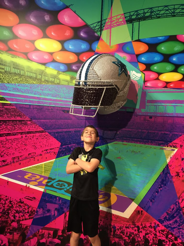 Peyton with the Dallas Cowboys helmet at Candytopia